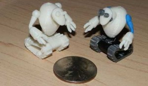 Huxter's Tread-Bots, placed next to a quarter for scale.