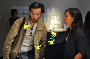 A patron looks amazedly at Corinne's 3D printed bees. The declining bee population in recent years has impacted California's flowering fruit and nut trees.