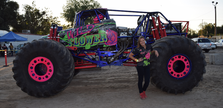 "Ramer with her monster truck, ""Wildflower."""