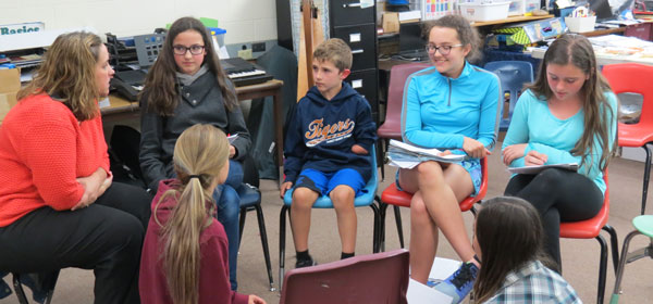 Ebelt's students meet with Carter for an interview, to learn more about him.