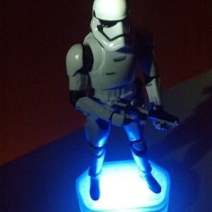 Tucker places a storm trooper on his 3D-printed display stand.