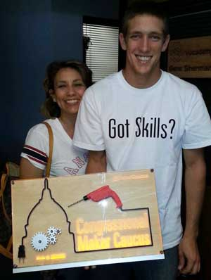 Dylan Harter created a sign for the Congressional Maker Caucus. The red and black drill is a 3D print.