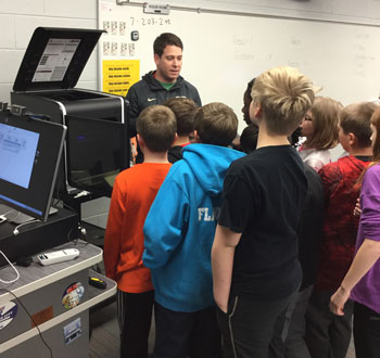 Miles talks about the H800 3D printer with students and answers questions