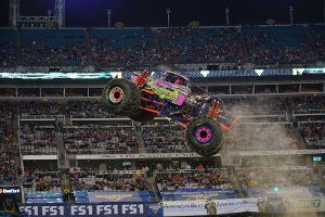 "Ramer catching ""big air"" in her monster truck, Wildflower."