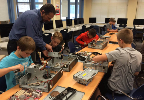 Students work on computers in the makerspace.