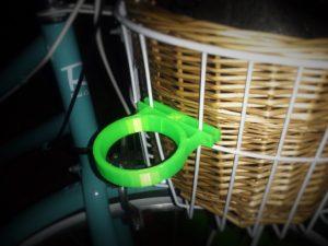 3D-printed coffee holder on bike basket