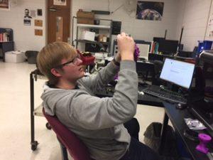 Student inspecting 3D-print