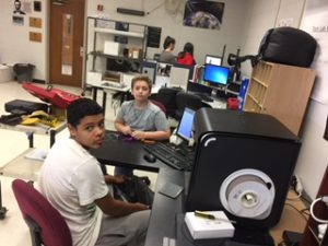Students with computer and H800 3D printer